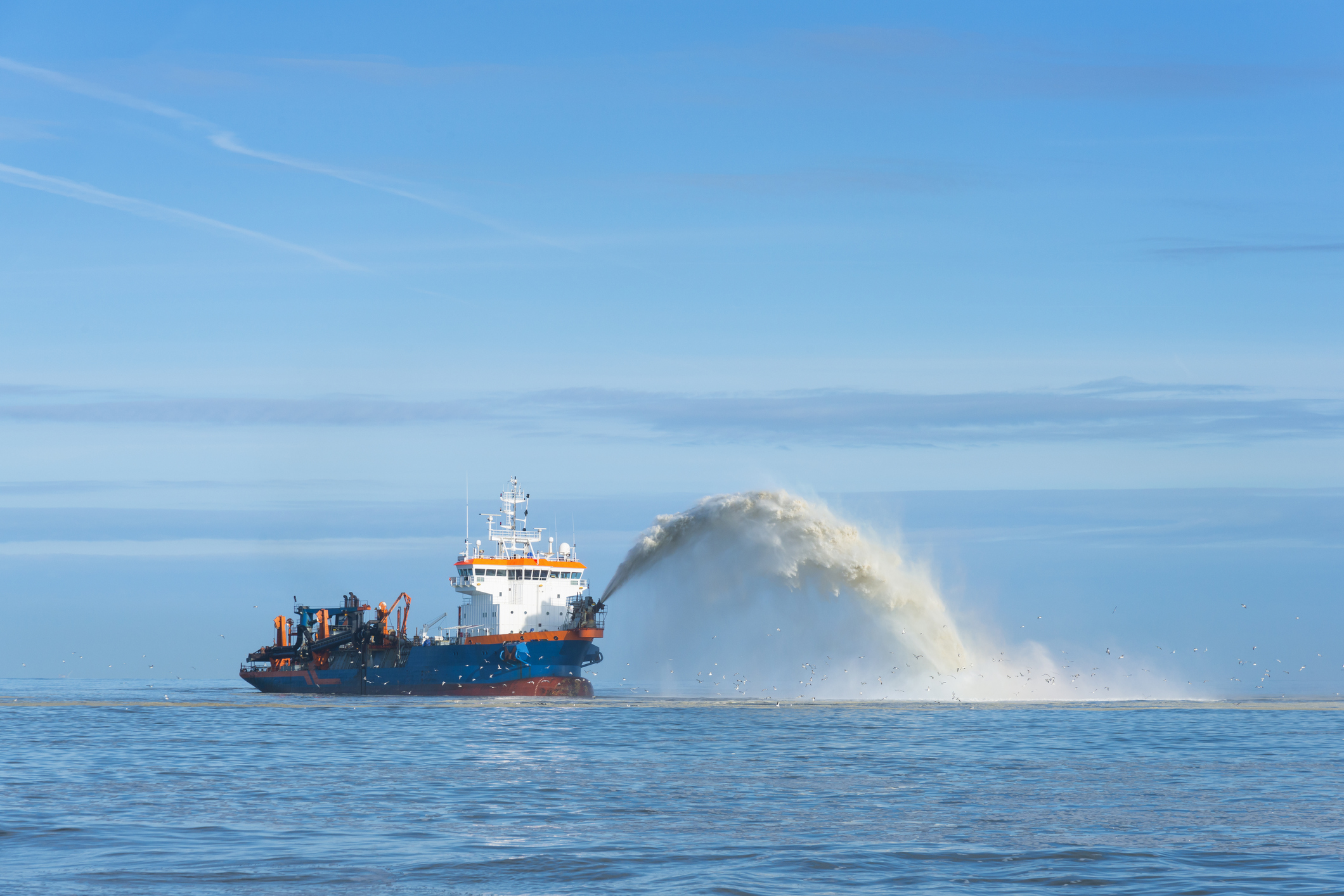 Dredging ship sea