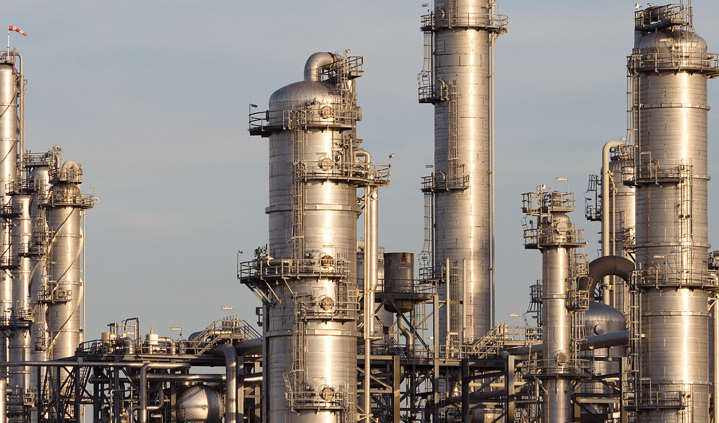 A refinery plant operating during the day.